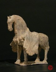 GRAY POTTERY FIGURE OF A CAPARISONED HORSE