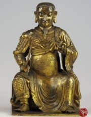 GILT BRONZE FIGURE OF SEATED ZHENWU THE TRUE WARRIOR