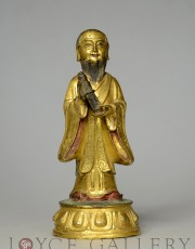 GILT BRONZE FIGURE OF A STANDING BODHISATTVA HOLDING A SCROLL