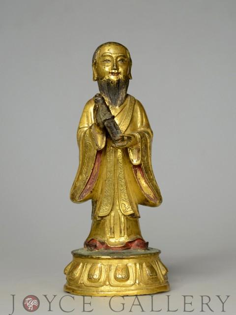 銅鎏金持經男相觀音立像