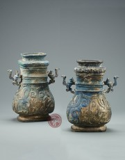 A PAIR OF ARCHAIC BRONZE FANG HU , WITH COVERS AND INTERLACED DRAGON MOTIF DECORATION
